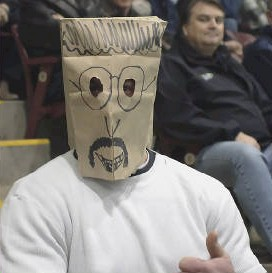 a sports fan with a paper bag over his head